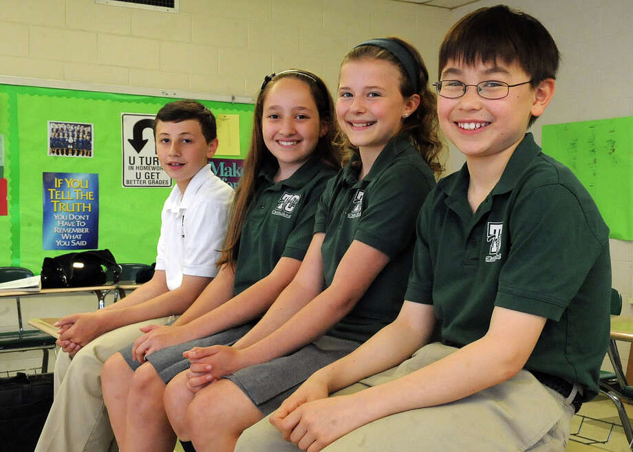 From left, Michael D'Elia, 11, Stephanie Tancs, 12, Kate Janik, 11, and Richard Focke, 12, pose for a photo at Trinity Catholic Middle School on Tuesday, May 15, 2012. The group of sixth-grade students won second place in the 2012 International Online Rube Goldberg Machine contest. Photo: Lindsay Niegelberg / Stamford Advocate