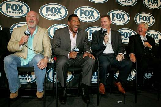 Terry Bradshaw, left, Michael Strahan, second from left, Howie Long, second from right, and Jimmy Johnson, right laugh while responding to questions during a news conference Tuesday, June 24, 2008  in New York. Strahan, the charismatic former New York Giants defensive end, who retired earlier this month, will join the FOX network's NFL pregame show. (AP Photo/Frank Franklin II) Photo: Frank Franklin II, STF / 2008 AP
