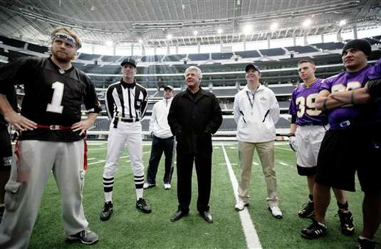 ** COMMERCIAL IMAGE ** In this photograph taken by AP Images for Crown Royal, Jimmy Johnson, center, gives a pep talk prior to the Crown Royal Jimmy Bowl in Arlington, Tx., Friday, Feb. 11, 2011. Winners of the Crown Royal Jimmy Bowl contest won an all expenses paid trip to Arlington, Tx., to compete in a flag football game coached by Jimmy Johnson. (Brandon Wade/AP Images for Crown Royal) Photo: Brandon Wade, FRE / AP2011