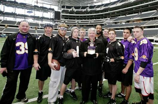 ** COMMERCIAL IMAGE ** In this photograph taken by AP Images for Crown Royal, Jimmy Johnson, center, poses with the winners of the Crown Royal Jimmy Bowl in Arlington, Tx., Friday, Feb. 11, 2011. Winners of the Crown Royal Jimmy Bowl contest won an all expenses paid trip to Arlington, Tx., to compete in a flag football game coached by Jimmy Johnson. (Brandon Wade/AP Images for Crown Royal) Photo: Brandon Wade, FRE / AP2011
