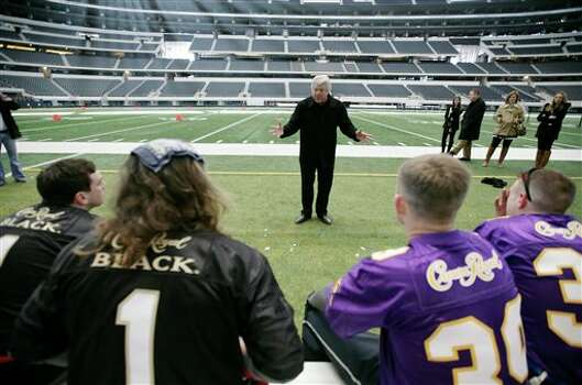 ** COMMERCIAL IMAGE ** In this photograph taken by AP Images for Crown Royal, Jimmy Johnson, center, gives a pep talk to the winners of the Crown Royal Jimmy Bowl contest before a flag football game in Arlington, Tx., Friday, Feb. 11, 2011. Winners of the Crown Royal Jimmy Bowl won an all expenses paid trip to Arlington, Tx., to compete in a flag football game coached by Jimmy Johnson. (Brandon Wade/AP Images for Crown Royal) Photo: Brandon Wade, FRE / AP2011