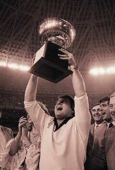 Oklahoma State Cowboys? coach Jimmy Johnson holding the Bluebonnet Bowl trophy up high on Saturday, Dec.  31, 1983 in Houston, Texas after his team beat the Baylor Bears 24-14 in the Bluebonnet Bowl game at the Houston Astrodome. (AP Photo) Photo: Anonymous, STF / AP1983