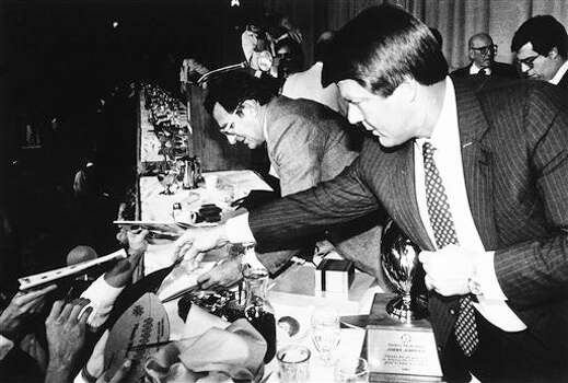Miami coach Jimmy Johnson (right) and Penn State coach Joe Paterno are swamped with autograph seekers at the close of the Fiesta Bowl kickoff  luncheon on Tuesday, Dec. 31, 1986 in Phoenix, Arizona. (AP Photo/Jim Gerberich) Photo: Jim Gerberich, STF / AP1986