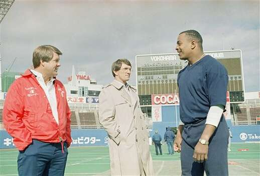 Miami coach Jimmy Johnson, left, and Alabama coach Ray Perkins, center, chat with Auburn running back Brent Fullwood during practice session on Saturday, Jan. 10, 1987 in Yokohama, Japan at the Yokohama Stadium, where Johnson?s East team take on the West in the Japan Bowl contest on Sunday. (AP Photo/Katsumi Kasahara) Photo: Katsumi Kasahara, STF / AP1987