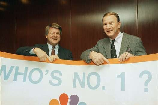 Miami Hurricanes coach Jimmy Johnson, left, meets with Oklahoma Sooners coach Barry Switzer to ask the question, ìWho will be No. 1?î, during a news conference on Wednesday, Dec. 9, 1987 in New Yorkís Marriott Marquis Hotel. The answer will be determined on the field New Yearís Day in Miami when the top ranked Sooners meet the Hurricanes in the Orange Bowl Classic. (AP Photo/Marty Lederhandler) Photo: Marty Lederhandler, STF / AP1987