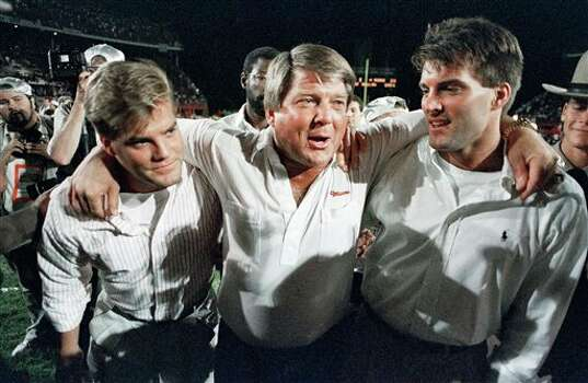 University of Miami head coach Jimmy Johnson, center, is hugged by his sons while walkiing off the field following a 23-3 win over the University of Nebraska in the 55th Orange Bowl Classic in Miami, Jan. 3, 1989.  (AP Photo/Chris O'Meara) Photo: Chris O' Meara, STF / 1989 AP