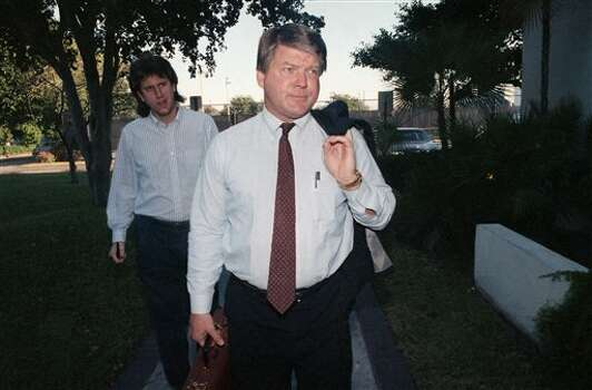 Jimmy Johnson, newly named head coach of the Dallas Cowboys, walks away from reporters on his way to an athletic meeting on Monday, Feb. 27, 1989 at the University of Miami in Coral Cables, Florida. (AP Photo/Bill Cooke) Photo: Bill Cooke, STR / AP1989