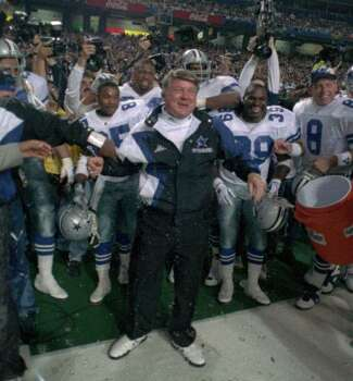 Former Dallas Cowboys coach Jimmy Johnson reacts on the sideline to being drenched after the Cowboys won Super Bowl XXVIII, 30-13, over the Buffalo Bills Jan. 30, 1994.  (AP Photo/Ron Heflin) Photo: RON HEFLIN, STF / 1994 AP