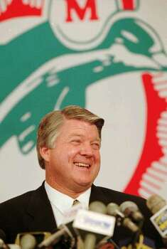 New Miami Dolphin head coach Jimmy Johnson smiles after signing a four year, eight million contract with the Dolphins, Thursday, Jan. 11, 1996 at the Dolphins training facility in Davie, Fla. (AP Photo/Jeffrey Boan) Photo: JEFFREY BOAN, STR / 1996 AP