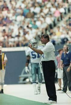 Jimmy Johnson, Dallas Cowboys football coach shown on sidelines during game against Washington Redskins on Sept. 20, 1992. (AP Photo/SGW) Photo: SGW, STR / AP1992