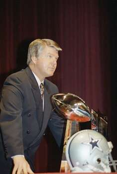 Dallas Cowboys Coach Jimmy Johnson poses with Vice Lombardi Trophy at press conference before Super Bowl XXVII on Friday, Jan. 30, 1993 in Pasadena. (AP Photo/Joe Cavaretta) Photo: Joe Cavaretta, STF / AP1993