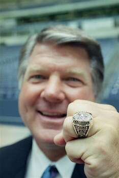 Dallas Cowboys head coach Jimmy Johnson displays his Super Bowl XXVII championship ring on Wednesday, June 3, 1993 in Irving, Texas. The ring has a dazzling five-point-shaped diamond in the center with 54 other diamonds jammed around it. The players are expected to get their rings in July. (AP Photo/Ron Heflin) Photo: Ron Heflin, STF / AP1993