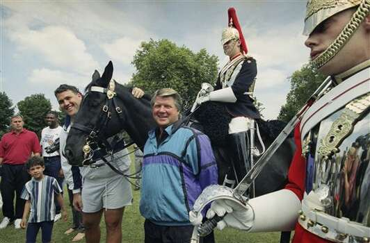 Jim Johnson, the Dallas Cowboys coach, meets up with Trooper Handley of the Blues and Royals on his horse Nexus as Lineman Kevin Gogan looks on Saturday, August 7, 1993 in London?s Hyde Park where the team was working out. At right is Trooper Royston of the Life Guards. The Guards and the Royals make up the ceremonial Household Regiment. (AP Photo/Alistain Grant) Photo: Alistain Grant, STR / AP1993