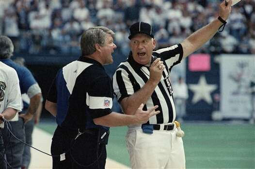 Dallas Cowboys coach Jimmy Johnson argues with back judge Jim Poole during the fourth quarter of their game with the San Francisco 49ers on Sunday, Oct. 17, 1993 in Irving, Texas. Dallas won 27-17. (AP Photo/Linda Kaye) Photo: Linda Kaye, STF / AP1993