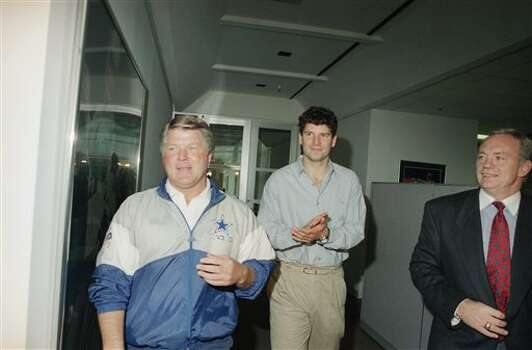 Dallas Cowboys coach Jimmy Johnson, left, and the newest Cowboy on the roster Bernie Kosar walk through the halls of the team?s practice facility on Wednesday, Nov. 10, 1993 in Irving, Texas. The Cowboys signed the former Cleveland Browns quarterback to a one year contract. (AP Photo/Ron Heflin) Photo: Ron Heflin, STF / AP1993