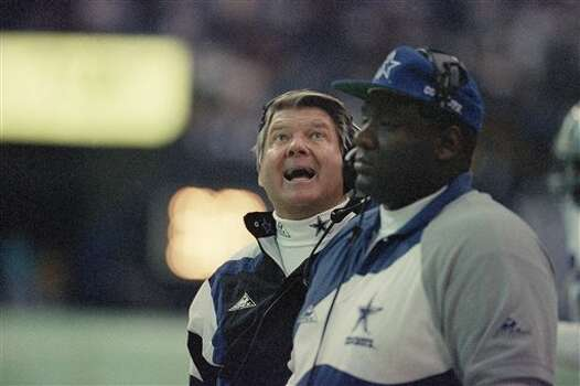 Dallas Cowboys coach Jimmy Johnson smiles as he looks at the replay in the first quarter of their game against the Philadelphia Eagles on Monday, Dec. 6, 1993 in Irving, Texas. (AP Photo/Pat Sullivan) Photo: Pat Sullivan, STF / AP1993