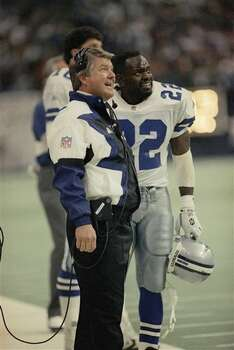 Dallas Cowboys coach Jimmy Johnson and running backs Emmitt Smith (22) watch a replay in the second quarter against the Philadelphia Eagles on Monday, Dec. 6, 1993 in Irving, Texas. (AP Photo/Linda Kaye) Photo: Linda Kaye, STF / AP1993