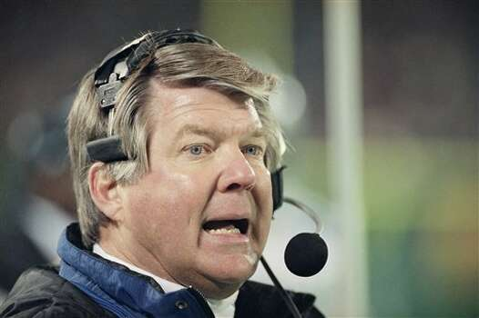 Dallas Cowboys head coach Jimmy Johnson talks on his headset during the fourth quarter against the New York Jets at Giants Stadium in East Rutherford, New Jersey on Saturday, Dec. 18, 1993. The defending Super Bowl champions beat the Jets 28-7 and assured themselves at least a wild-card playoff berth. (AP Photo/Mark Lennihan) Photo: Mark Lennihan, STF / AP1993
