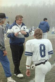 Dallas Cowboys coach Jimmy Johnson talks with quarterback Troy Aikman at the start of practice in Suwanee, Georgia on Friday, Jan. 28, 1994. The Cowboys are playing the Buffalo Bills in the Super Bowl on Sunday in the Georgia Dome. (AP Photo/Ron Heflin) Photo: Ron Heflin, STF / AP1994