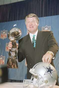 Dallas Cowboys head coach Jimmy Johnson poses with the Super Bowl trophy and a Cowboys helmet at a news conference in Atlanta on Friday, Jan. 28, 1994. His team faces the Buffalo Bills in the Super Bowl on Sunday. (AP Photo/Ron Heflin) Photo: Ron Heflin, STF / AP1994