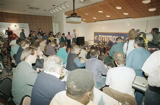 Members of the news media gather to listen to former Dallas Cowboys head coach Jimmy Johnson announce he is leaving the team on Tuesday, March 29, 1994 in Irving, Texas. Johnson was accompanied by team owner Jerry Jones. (AP Photo/Tim Sharp) Photo: Tim Sharp, STF / AP1994