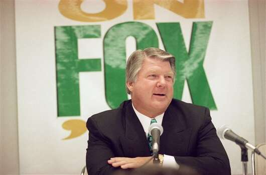 Former Dallas Cowboys coach Jimmy Johnson speaks at a New York news conference held by Fox Sports on Thursday, April 21, 1994 after he was introduced as a member of the network?s pre-game studio broadcast team. Johnson will join Terry Bradshaw and Howie Long on the show, created after Fox won the rights to televise the NFL?s NFC games by outbidding CBS with a $1.58 billion bid for four years. (AP Photo/Ed Bailey) Photo: Ed Bailey, STF / AP1994