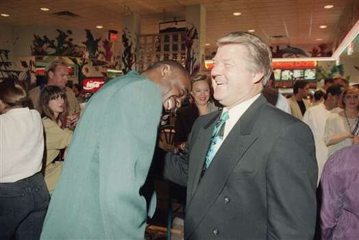 Former Dallas Cowboys head coach Jimmy Johnson shares a laugh with Cowboys wide receiver Michael Irvin during Sunday?s opening of a Miami Subs Grill in Dallas on May 8, 1994  where Johnson is a part owner. During the football season Johnson will be in Dallas every Monday night doing a one-hour television show from the restaurant. (AP Photo/Ron Heflin) Photo: Ron Heflin, STF / AP1994