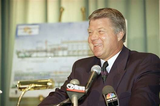 Dallas Cowboys coach Jimmy Johnson responds to a question at a news conference at the Eden Roc Hotel in Miami Beach, Florida on Thursday, Nov. 3, 1994 where he unveiled plans to open a restaurant at the hotel next January in time for Super Bowl week in Miami. (AP Photo) / AP1994