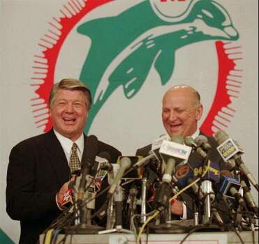New Miami Dolphins head coach Jimmy Johnson, shares a laugh with team owner Wayne Huizenga at a press conference in Davie Fla. Thursady January 11, 1996. Johnson signed a 4-year $8 million contract. (AP Photo/Jeffrey Boan) Photo: JEFFREY BOAN, STR / AP1996