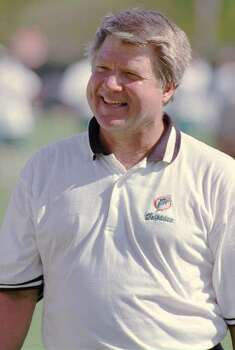 Miami Dolphins head coach Jimmy Johnson is all smiles after mini camp were he striped the ball from running backs and competed with defensive backs, during agility drills at the team's training facility in Davie, Fla., Friday, April 26, 1996. (AP Photo/Gary I. Rothstein) Photo: GARY I ROTHSTEIN, STR / 1996 AP