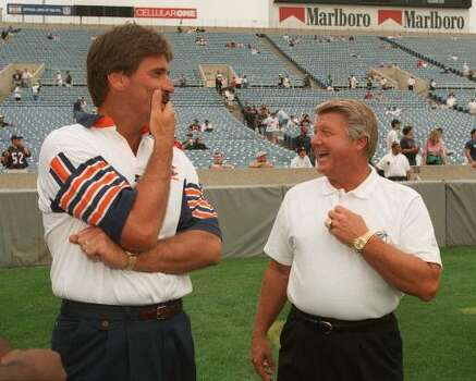 Chicago Bears coach Dave Wannstedt, left, and Miami Dolphins coach Jimmy Johnson chat before their teams' preseason game Sunday, Aug. 11, 1996, at Soldier Field in Chicago. Wannstedt was an assistant coach with the Dallas Cowboys when Johnson coached the Cowboys. The Bears beat the Dolphins 24-21. (AP Photo/David Boe) Photo: DAVID BOE, STF / 1996 AP