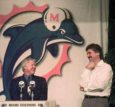 Miami Dolphins coach Jimmy Johnson, left, shares a laugh with Dave Wannstedt as they address the media Thursday, Jan. 14, 1999 at the Dolphins training facility in Davie, Fla. Johnson announced Wannstedt as the new assistant head coach of the Dolphins and quashed a rumor of the night before that Johnson would resign as the head coach. (AP Photo/Wilfredo Lee) Photo: WILFREDO LEE, STF / 1999 AP