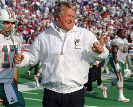 Miami Dolphins head coach Jimmy Johnson reacts after his team beat the Buffalo Bills 21-7 Sunday, Oct. 13, 1996, at Rich Stadium in Orchard Park, N.Y. At left is Dolphins punter John Kidd (17). Johnson will face his former team, the Dallas Cowboys Sunday, Oct. 27, 1996 in Miami. (AP Photo/Bill Sikes) Photo: BILL SIKES, STF / 1996 AP