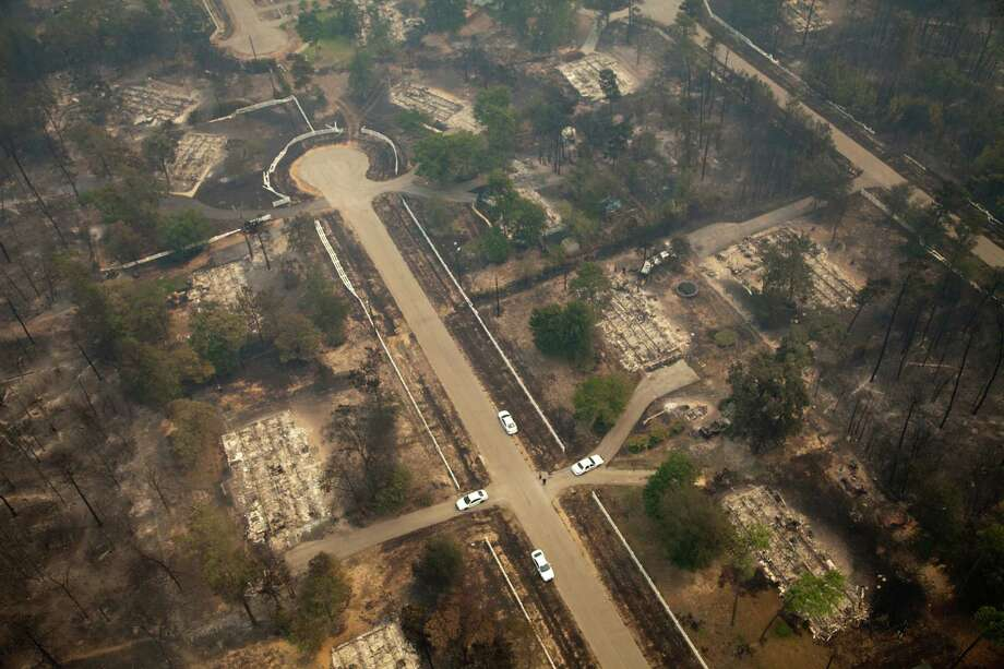 A wildfire swept through a neighborhood in September 2011 near Magnolia. The residents of the Windsor Hills neighborhood of The Woodlands are working to ensure the community has done all it can to help prevent future wildfires. Photo: Smiley N. Pool / © 2011  Houston Chronicle