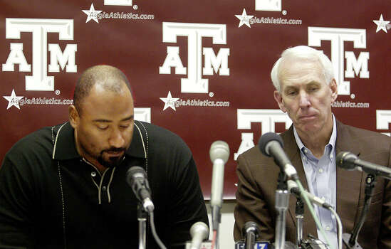 Texas A&M head coach R.C. Slocum, right, and defensive coach  Buddy Wyatt, left, appear at a news conference where the two discussed the death of player Brandon Fails Monday, Nov. 25, 2002, at Kyle Field in College Station, Texas.  Fails collapsed today in his dorm room and was taken to St. Joseph Regional Health Center in Bryan Texas where he later died. Fails was taken to St. Joseph Regional Health Center in Bryan, Texas where he died Monday, Nov. 25, 2002, after complaining to his roommate he was having trouble breathing.  The cause of death was not released by the school or the hospital.  (AP Photo/Richard Carson) Photo: RICHARD CARSON, STR / AP2002