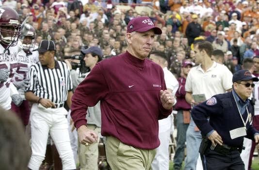 Texas A&M head coach R.C. Slocum runs to the field with his team as they prepare to play Texas in Austin, Texas, Friday, Nov. 29, 2002. (AP Photo/Eric Gay) Photo: ERIC GAY, STF / 2002 AP
