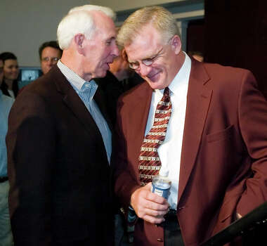 Former Texas A&M football coach and friend R.C. Slocum, left, and new Texas A&M football coach Mike Sherman talk after a news conference to introduce Mike Sherman Monday, Nov. 26, 2007 at Texas A&M University in College Station, Texas. Sherman was the offensive line coach on R.C. Slocum's coaching staff during the 80s and 90s.(AP Photo/Paul Zoeller) Photo: Paul Zoeller, STR / AP2007