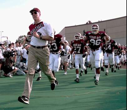 Texas A&M football coach R.C. Slocum leads his team onto Kyle Field in this 1995 file photo, in College Station, Texas, during the team's final Southwest Conference season. Slocum and the 1996 team will play in the new Big 12 Conference. (AP Photo/Eric Gay) Photo: ERIC GAY, STF / AP1996