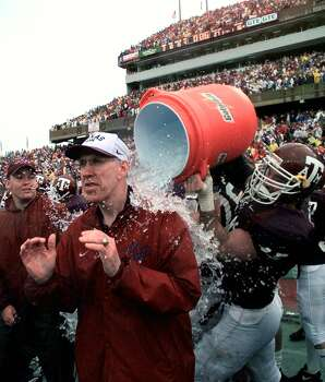Texas A&M coach R.C. Slocum is doused with water after the Aggies beat the Texas Longhorns Friday, Nov. 28, 1997 in College Station, Texas. Texas A&M will face Nebraska in the Big 12 championship game Saturday in San Antonio. (AP Photo/David J. Phillip) Photo: DAVID J. PHILLIP, STF / AP1997