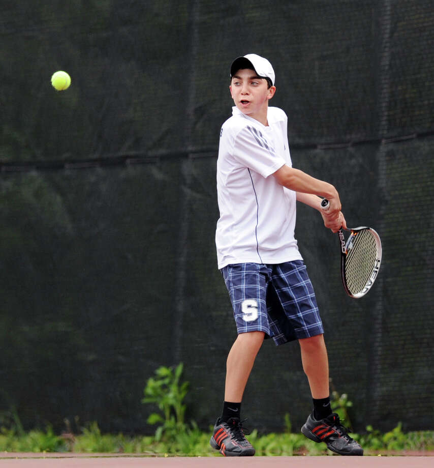 Staples' Josh Moskovitz lines up a backhand against Greenwich May 1. On Thursday, Moskovitz won a pivotal match at third singles in a 4-3 win over Westhill. Photo: Bob Luckey, Bob Luckey/Staff Photographer / Greenwich Time