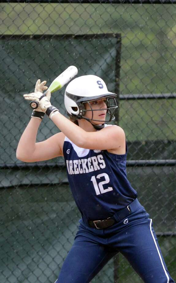 Staples' Maggie Mills (12) at bat against Darien April 25. On Monday, Mills had two hits in an 8-7 win at Ridgefield. Photo: Amy Mortensen, Amy Mortensen / For The Westport News / Stamford Advocate Freelance