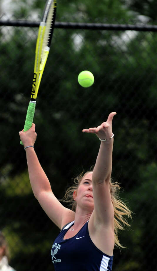 Staples' Kate Collins serves against Fairfield Warde April 24. On Saturday, Collins won in straight sets at second singles in a 5-2 win at Darien. Photo: Christian Abraham, Christian Abraham/Staff Photographer / Connecticut Post