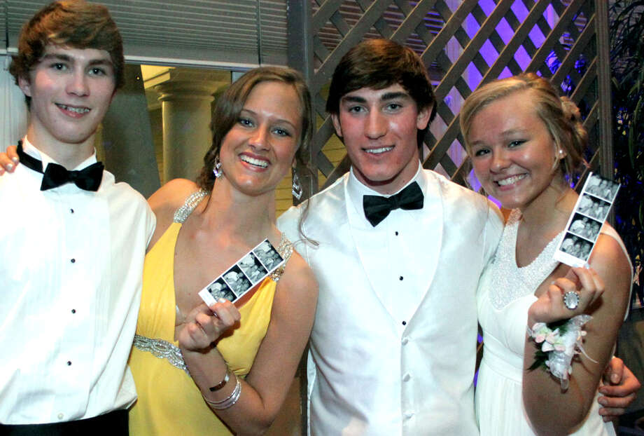 Showing off the images captured in the photo booth during the 2012 New Milford High School junior prom are, from left to right, James Lord, Emily Gribble, Tyler Clark and Valerie Heinonen. May 5, 2012 at the Amber Room Colonnade in Danbury Photo: Walter Kidd