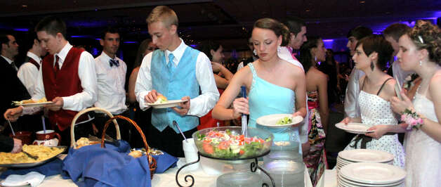 Hungry teens indulge at the buffet line during the 2012 New Milford High School junior prom, May 5, 2012 at the Amber Room Colonnade in Danbury Photo: Walter Kidd