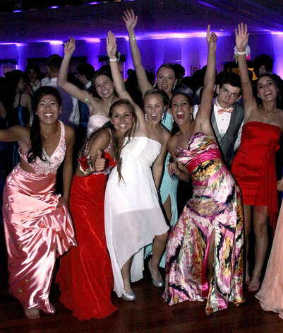 A single guy somehow manages to find himself a midst of female prom-goers during the 2012 New Milford High School junior prom, May 5, 2012 at the Amber Room Colonnade in Danbury Photo: Walter Kidd