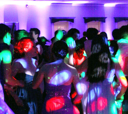 Pulsating lights decorate the dance floor and students alike during the 2012 New Milford High School junior prom, May 5, 2012 at the Amber Room Colonnade in Danbury Photo: Walter Kidd
