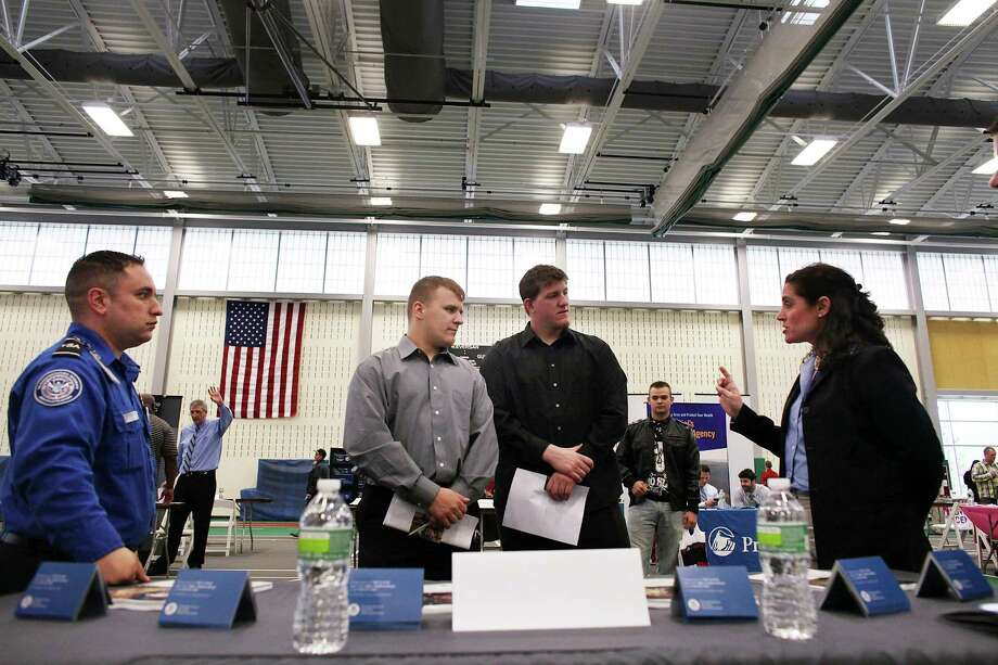 UTICA, NY - MAY 15:  Veterans Kris Hummel (left) and Shane Foley, both of whom currently do not have work, speak with a representative from the TSA at the Hiring Our Heroes Veterans/Military job fair on May 15, 2012 in Utica, New York. Like many upstate New York communities, Utica is struggling to make the transition from a former manufacturing hub. The city's individual poverty rate is twice the national average with an unemployment rate of 9.8% as of February 2012. Citing Utica's weakening financial margins over the past two years, Fitch Ratings downgraded its credit rating on Utica by two notches to a triple-B, two rungs above junk territory. Photo: Spencer Platt, Getty Images / 2012 Getty Images