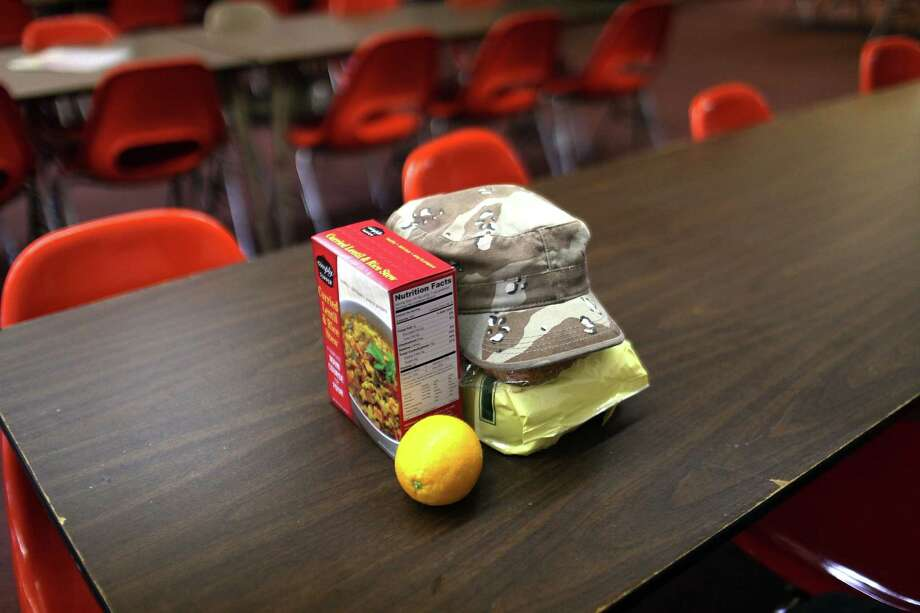 UTICA, NY - MAY 15:  A man's free groceries sit ona table at the Mother Marianne's West Side Soup Kitchen on May 15, 2012 in Utica, New York. Like many upstate New York communities, Utica is struggling to make the transition from a former manufacturing hub. The city's individual poverty rate is twice the national average with an unemployment rate of 9.8% as of February 2012. Citing Utica's weakening financial margins over the past two years, Fitch Ratings downgraded its credit rating on Utica by two notches to a triple-B, two rungs above junk territory. Photo: Spencer Platt, Getty Images / 2012 Getty Images