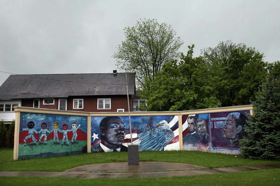 UTICA, NY - MAY 15: A mural celebrating American history is seen May 15, 2012 in Utica, New York. Like many upstate New York communities, Utica is struggling to make the transition from a former manufacturing hub. The city's individual poverty rate is twice the national average with an unemployment rate of 9.8% as of February 2012. Citing Utica's weakening financial margins over the past two years, Fitch Ratings downgraded its credit rating on Utica by two notches to a triple-B, two rungs above junk territory. Photo: Spencer Platt, Getty Images / 2012 Getty Images