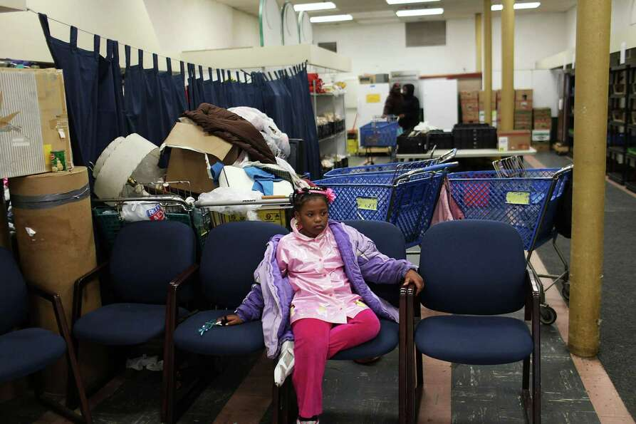 UTICA, NY - MAY 15:  A girl waits for her mother at a food bank on May 15, 2012 in Utica, New York.